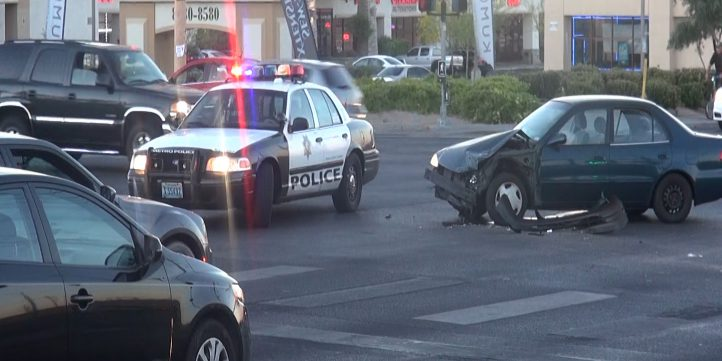 Police Car Next To Crashed Car