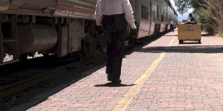 train conductor walking on platform