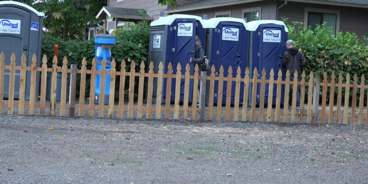 People Using Outhouses
